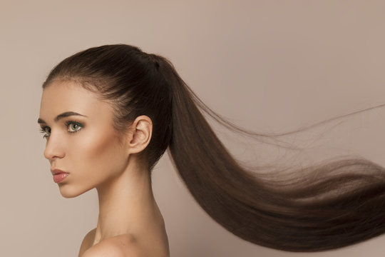 Beautiful woman with long healthy brown ponytail