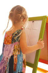 girl draws on a white background