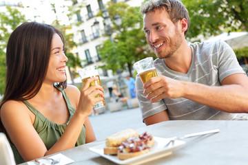 Couple eating tapas drinking beer in Madrid Spain