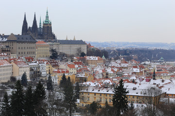 First Snow in Prague City with gothic Castle, Czech Republic