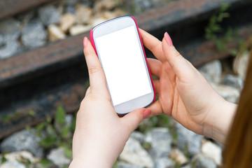 Woman Holding Smart Phone on Railway
