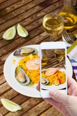 making photo of paella