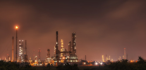 Big Industrial oil tanks in a refinery with treatment pond at in