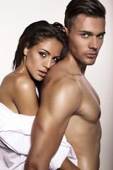 sexy tender couple posing in studio