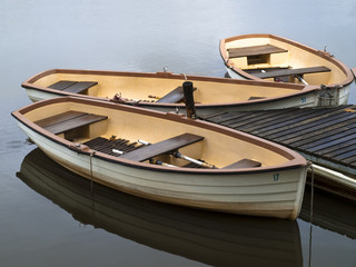 Old style wooden row boats at dock