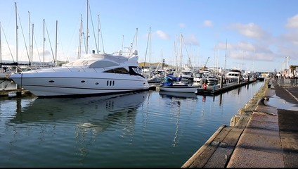 Fototapete - Poole harbour and quay Dorset England UK with yachts and boats