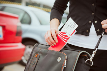 Travel: Woman Pulls Travel Ticket Out Of Bag