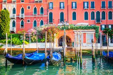 Venice, Italy - gondolas at pier on water canal