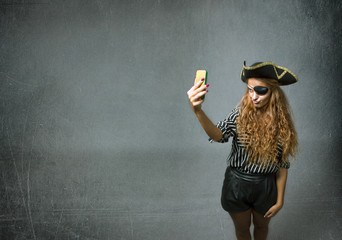 pirate taking selfie with telephone
