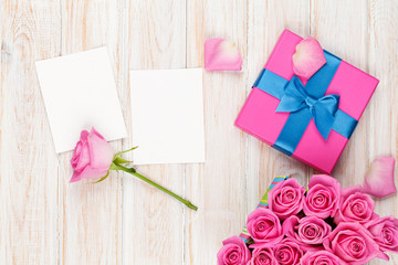 Valentines day background with gift box full of pink roses and t