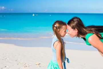 Mother and little girl have fun on summer vacation