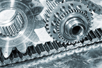 cogwheels and gears powered by powerful steel chains