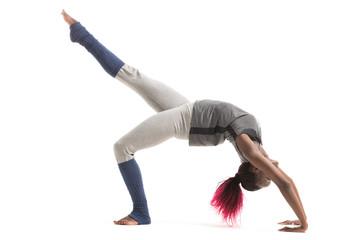 Woman doing yoga indoors