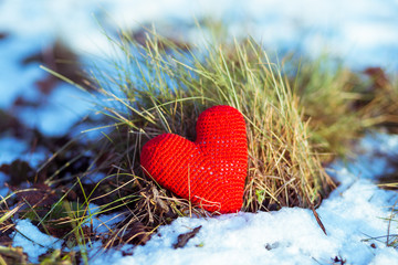 red heart on snowy ground