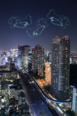 heart sparkle Fireworks celebrating over Tokyo cityscape at nigh