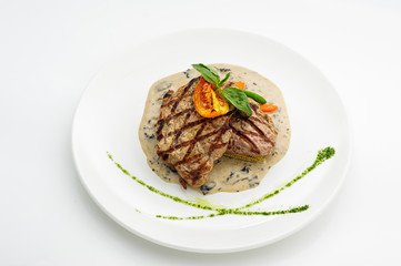 Grilled steak on white plate
