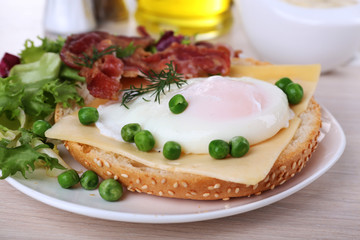 Sandwich with poached egg, cheese and bacon