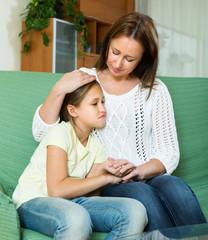 Woman comforting sad  daughter