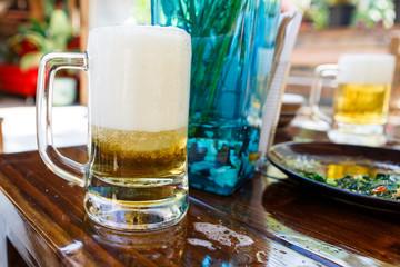 Beer with foam in restaurant