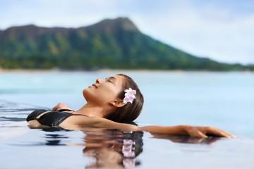 Wall Mural - Hawaii vacation wellness pool spa woman relaxing