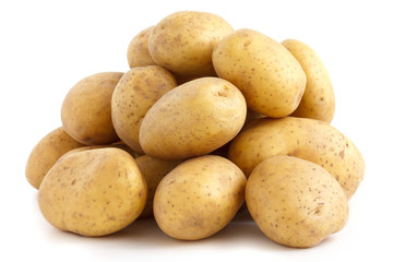 Pile of potatoes arranged on white.