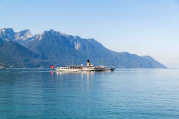 A boat floating in Geneva  lake in Switzerland