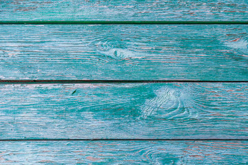 Old wooden planks with peeling green paint