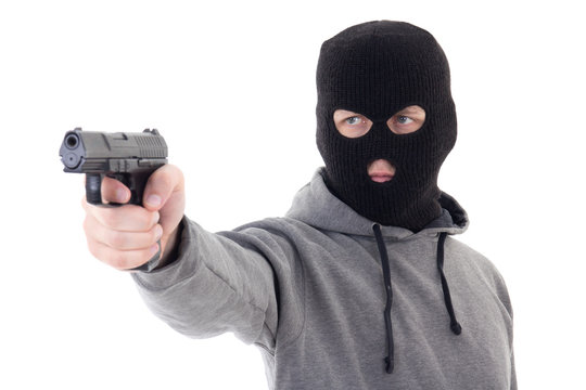 burglar or terrorist in mask aiming with gun isolated on white