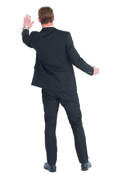 Rear view of businessman in suit gesturing