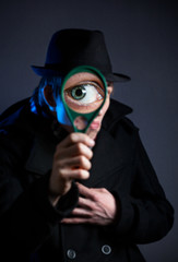 Detective with magnifier glass