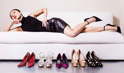 Wall Mural - Beautiful woman with many shoes