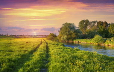 Wall Mural - Colorful spring sunset on the river.