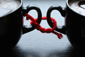 Two cups of coffee related red thread