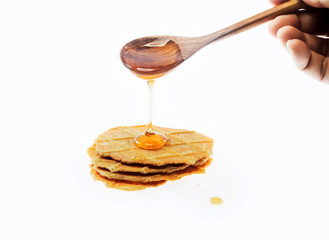 Honey dripping on breads from wooden spoon