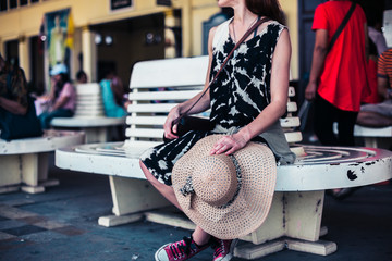 Young woman waiting at train station