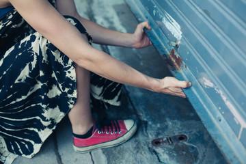 Woman unlocking garage door