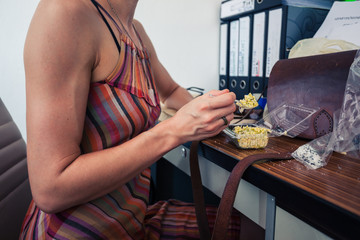 Woman having lunch in office