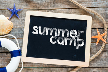 Summer camp Text on blackboard