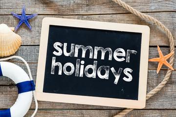 Summer holiday Text on blackboard