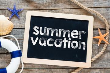 Summer vacation Text on blackboard