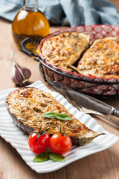 baked eggplant stuffed with cheese, cottage cheese and herbs