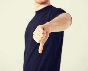 man showing thumbs down