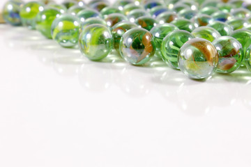 Colorful marbles on white background