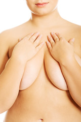 Overweight woman covering breast