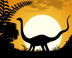 Dinosaur silhouette on sunset background.