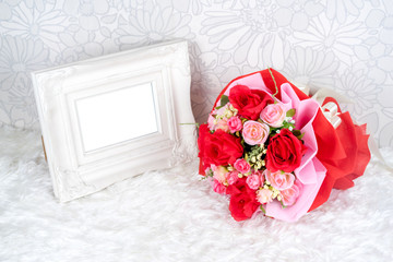 flowers bouquet placed with picture frame