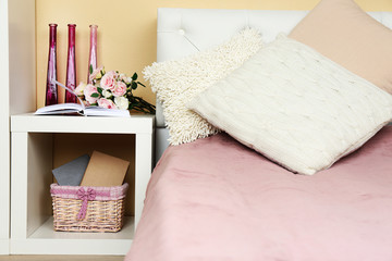 Modern colorful bedroom interior with bed and nightstand, with