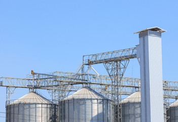 exterior structure of new agriculture silo building against blue