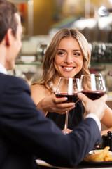 Beautiful couple having romantic dinner at restaurant.