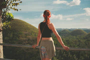 Woman admiring view of chocolate hils in Philippines
